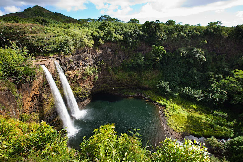 Behold Wailua Falls, a 113-foot waterfall near Lihue on Kauai that feeds into the Wailua River.