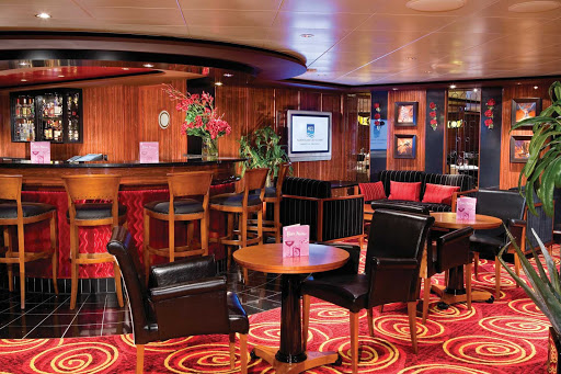Norwegian-Pearl-Star-Bar - Relax with a cocktail at the Star Bar, located on deck 13 of Norwegian Pearl.