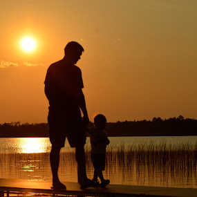 Sunset, Wolf Lake, Minnesota by Kathleen Koehlmoos - Landscapes Sunsets & Sunrises ( gorgeous sunset, sunset, father and son, beautiful sunset, wolf lake sunset, silhouettes, families,  )