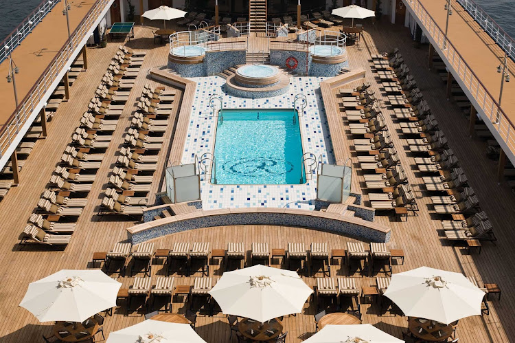 Spend the afternoon bathing in the sun on the spacious pool deck of Seven Seas Mariner.