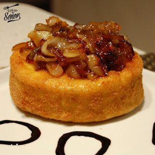 Camembert Cheese Topped with Caramelized Onions.