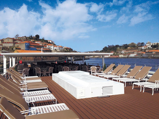Uniworld-Queen-Isabel-sun-deck-lounge - Take in the sights of the Douro River while soaking up the sun on the deck of Uniworld's Queen Isabel.