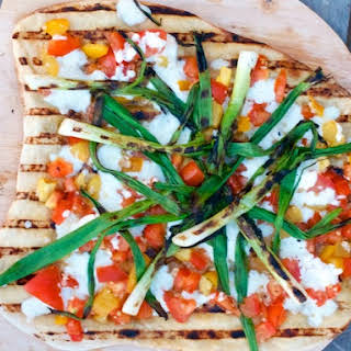 Grilled Pizza with Heirloom Tomato Checca & Scallions.
