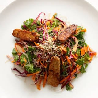Kelp Noodle and Cabbage Salad with Seared Tempeh and Carrot Orange Miso Dressing.