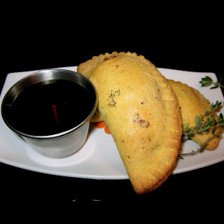 Caramelized Pear and Bacon Empanadas with Thyme Maple Syrup.