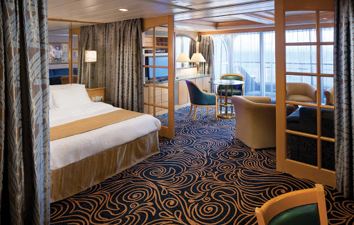 Splendour-of-the-Seas-Owner-Suite - The Owner's Suite aboard Splendour of the Seas features a queen-size bed, private balcony, separate living area and other amenities.
