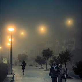 Can you feel the foggy night? by Sergio Moya - City,  Street & Park  Street Scenes ( foggy, ligth, night scene, street, couple, night, run, people )