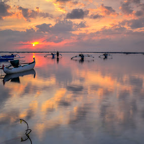 sunrise and boat  by Nicholas Pinot oetomo - Landscapes Sunsets & Sunrises ( clouds, water, bali, sunrises, waterscape, skyscrapers, boats, cloudscape, oranges, seascape, indonesia, landscape photography, skylines, landscapes,  )