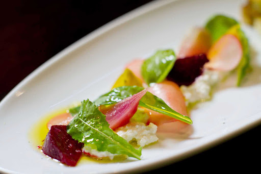 150-Central-Park-Royal-Caribbean-appetizer-2-1 - A goat cheese, beets and micro-greens salad served at Allure of the Seas' 150 Central Park restaurant.