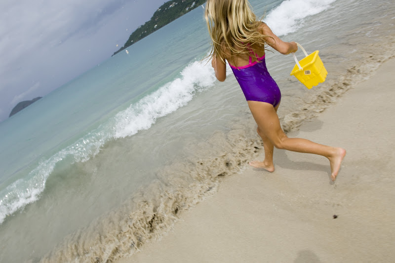 A girl plays in the surf at Magens Bay on St. Thomas.