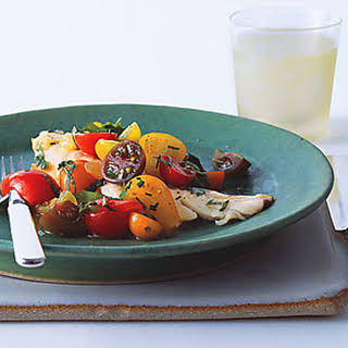 Fish with Curried Cucumber Tomato Water and Tomato Herb Salad.