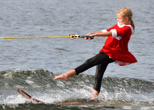 "A junior member of the Tampa Bay Water Ski Show Team performs a ""Christmas In July"" presentation."