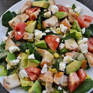 Spinach Salad with Chicken, Avocado, and Corn.