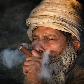 Bliss !! by Vinod Chauhan - People Portraits of Men ( priest, sulpha, baba, smoking, holy place, india, smoke )