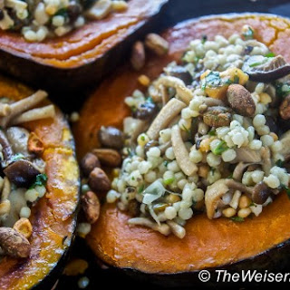 Acorn Squash Stuffed with Couscous, Mushroom Confit, Dried Pears, and Spicy Pistachios