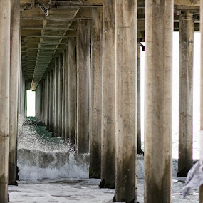 Under the HB Pier by Dory Formiller - Buildings & Architecture Bridges & Suspended Structures ( water, white waves, color, blue, waves, pier, brown, ocean, long, salt water,  )