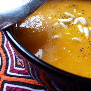 Cream of Pumpkin Soup with Corn and Pine Nuts