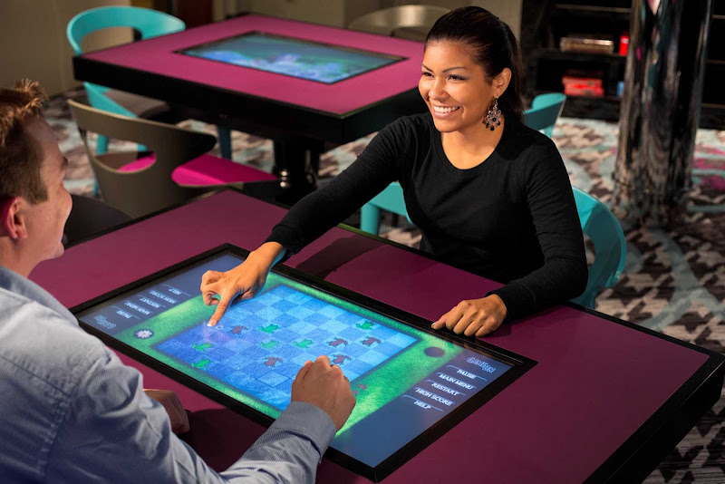 Challenge your partner to a game or two in Celebrity Reflection's Game On room.