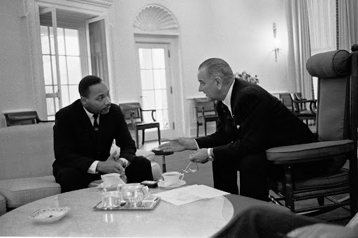 Martin Luther King, Jr. talks with President Lyndon B. Johnson.