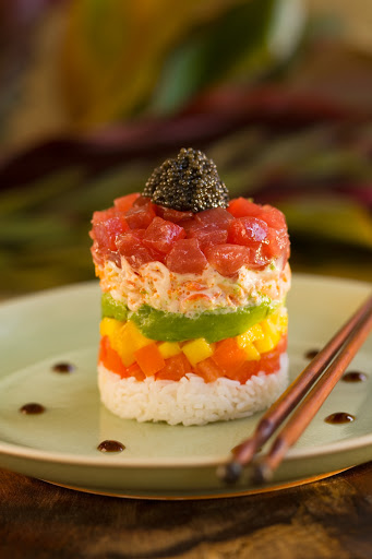 "layered-ahi-poke - Layered ahi poke cuisine. Poke (pronounced POH-kay) is served in most Hawaiian restaurants as a side dish or appetizer. In Hawaiian, poke means ""cut piece"" or ""small piece."""