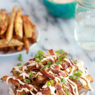 Double-Baked Fries with Garlic Cheese Sauce and Bacon.
