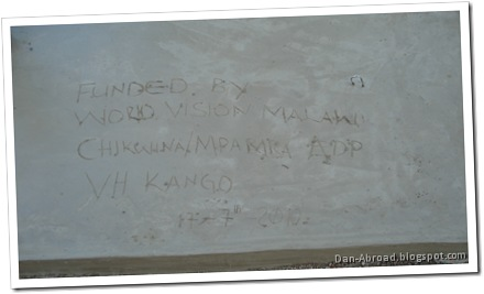 This reads: Funded by World Vision Malawi, Chikwina/Mpamba ADP, VH (village headman) Kango