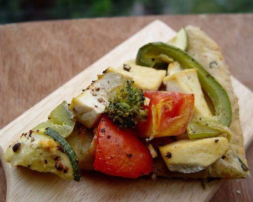 Vegan Masala Crust Pizza with Marinaded Tofu, Capsicum, Tomato, Broccoli and Zucchini