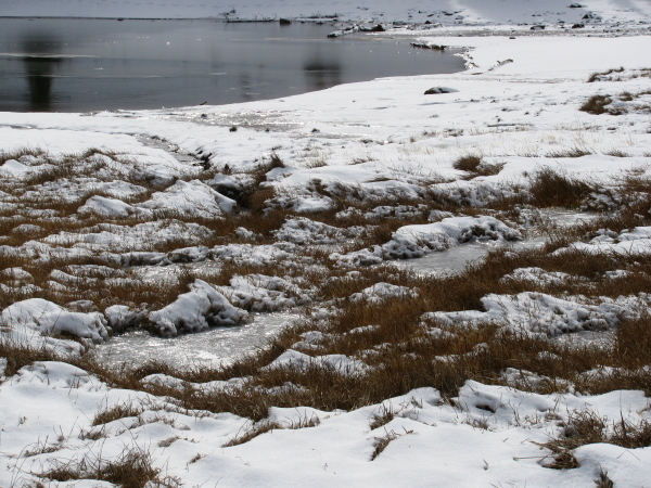Water still feeding the lakes and leaving trails in the snow.
