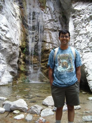 Ravi in front of falls and pool