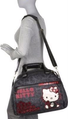 3cd4069b2 Large Hello Kitty face on front exterior. Interior backside wall has a  zipper pouch. Additional shoulder strap for longer length