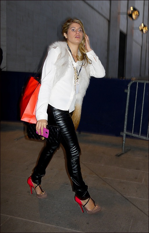 w black leather pants red heeled shoes white fur chanel clutch