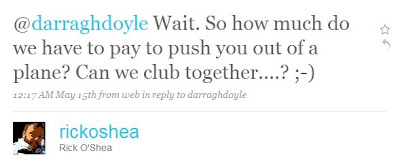text reads@darraghdoyle Wait. So how much do we have to pay to push you out of a plane? Can we club together....? ;-)