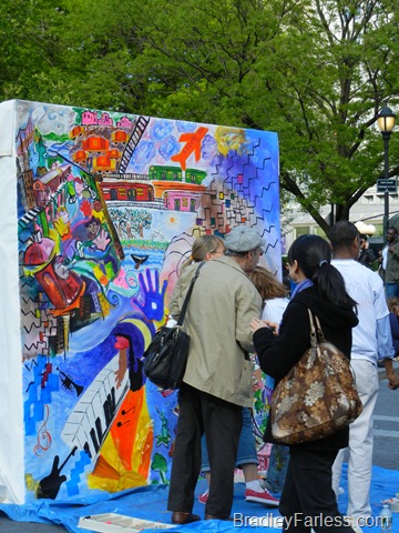 A group of people doing a large painting in Union Square.