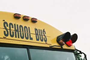 educations school day care school bus close up view of top of yellow school bus.jpg