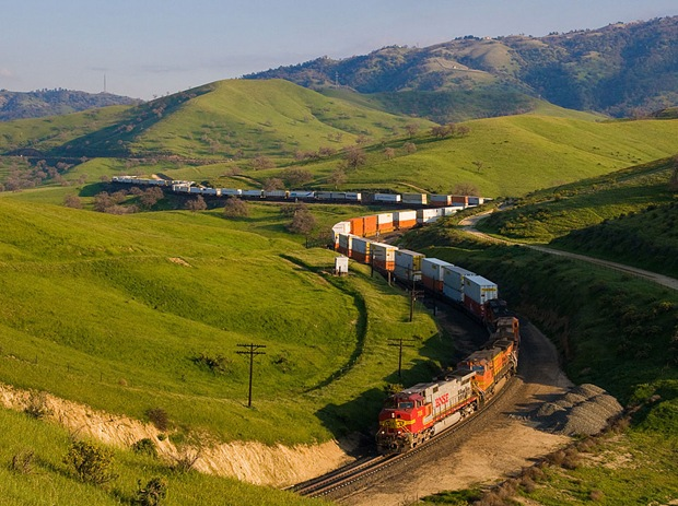 A BNSF Z train wound through the curves at Bealville during the spring in the Tehachapis at Caliente, California, USA