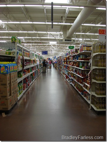 A long view down an aisle at a Super Walmart.