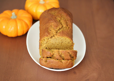 overhead photo of a sliced pumpkin bread loaf