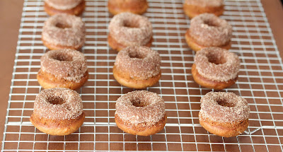 photo of Mini Apple cider donuts on a baking rack
