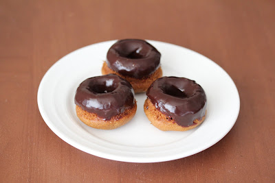 photo of three donuts on a plate
