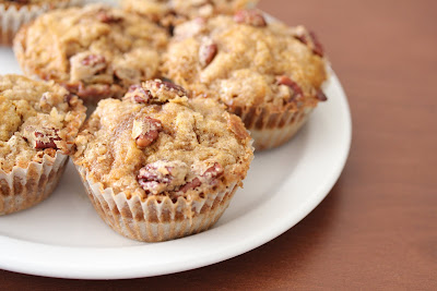 close-up photo of a plate of Pecan streusel pumpkin muffins