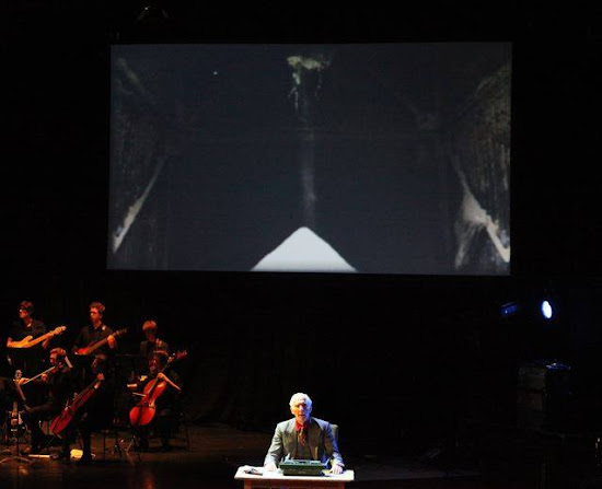 <p> <em>&#39;Language is a Virus from Outer Space&#39; by Richard Strange and Gavin Bryars at the Queen Elizabeth Hall, Southbank, London, Oct 2014</em></p> <p> Pictured is Richard Dryden as William S. Burroughs, sitting below &quot;Time, Time, Time...&quot;</p>