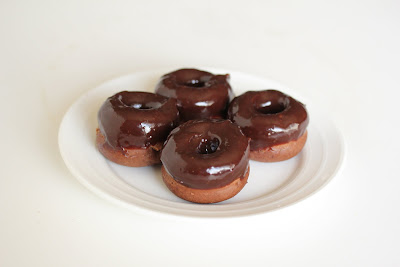 photo of four mini cake donuts on a plate