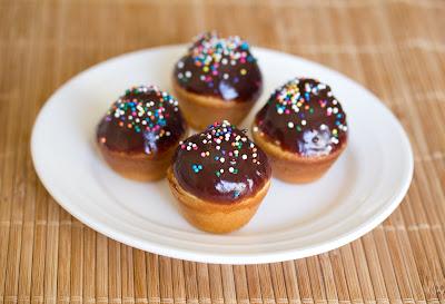 photo of four Mini Doughnut Muffins on a plate