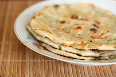 photo of a stack of scallion pancakes on a plate