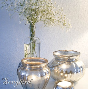 Mercury glass candles and white flowers