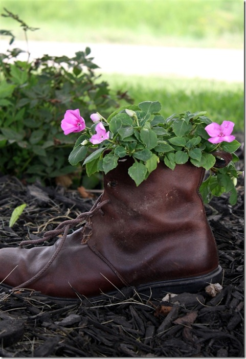 Plant flowers inside old shoes or boots!