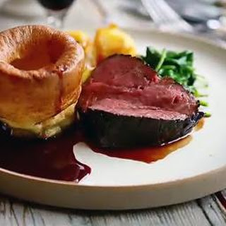 Treacle-cured beef with Yorkshire puddings and roast potatoes
