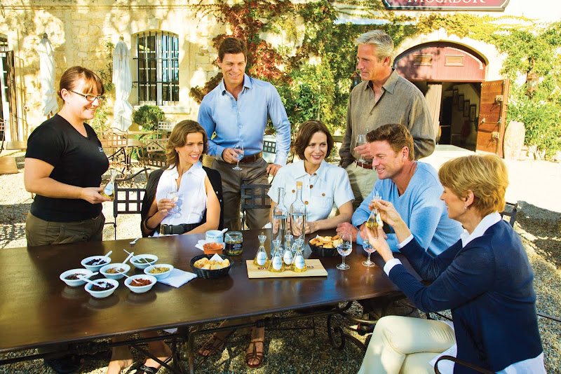 On a Seabourn cruise shore excursion, your mom can meet new people and try new activities, like this tasting in the South of France.