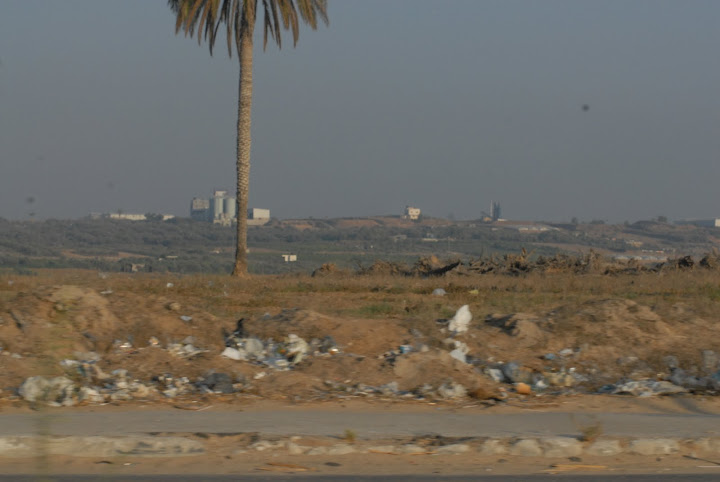 An area bordering Israel, bombed then bulldozed by them, that used to be full of orange and lemon trees. Sameh Habeeb. All rights reserved.