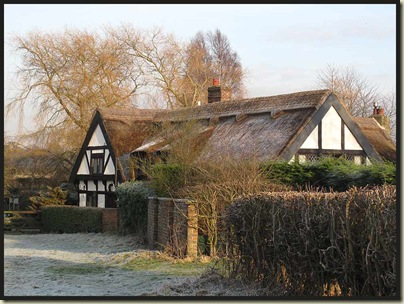 A pretty thatched cottage near Bucklow Hill